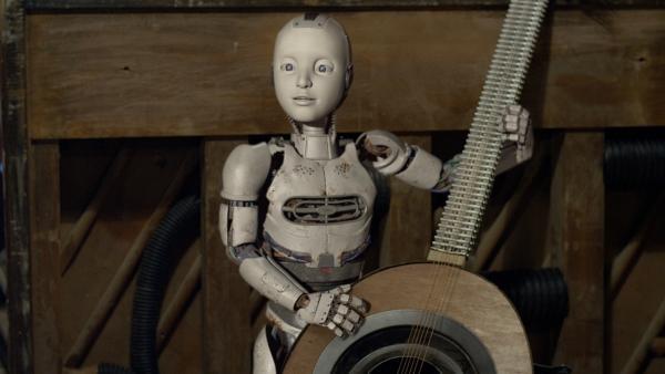 PAL (Millie Davis) mit der neuen Schrottgitarre | Rechte: KiKA/Sinking Ship Entertainment