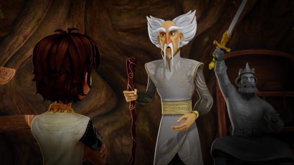 Arthur bittet seinen Mentor, den Zauberer Merlin, um Hilfe. | Rechte: SWR/Blue Spirit Productions/TéléTOON+/Canal+