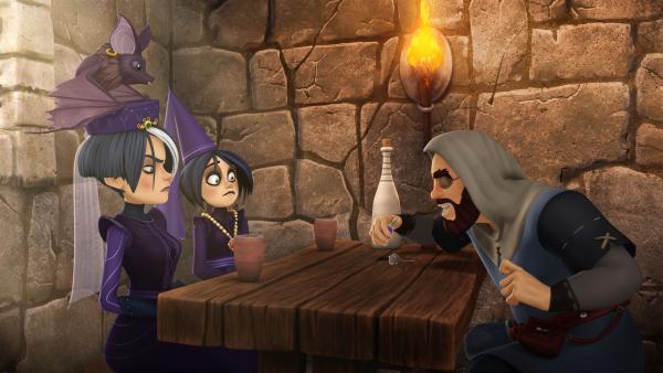 Ein verschlagener Händler möchte den Tintagel-Schwestern einen Werwolftrank aufschwatzen. | Rechte: SWR/Blue Spirit Productions/TéléTOON+/Canal+