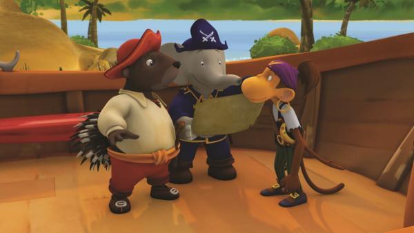 Badou entdeckt unter den Planken des Piratenbootes zufällig eine Schatzkarte. | Rechte: KiKA/Nelvana Limited/TeamTO/YTV Productions