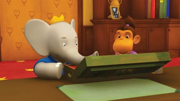 Badou und Chiku entdecken in König Babars Büro eine geheimnisvolle Flöte.   Rechte: KiKA/Nelvana Limited/TeamTO/TF1