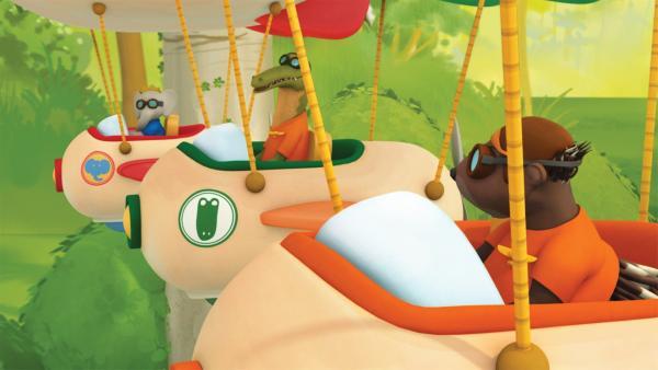 Badou, Dieter und Munroe fliegen in ihren Vollgasballons. | Rechte: KiKA/Nelvana Limited/TeamTO/TF1