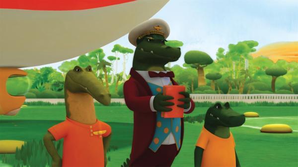 Botschafter Krokodilus hat vor, König Babar die Pilotenschwingen abzunehmen. | Rechte: KiKA/Nelvana Limited/TeamTO/TF1