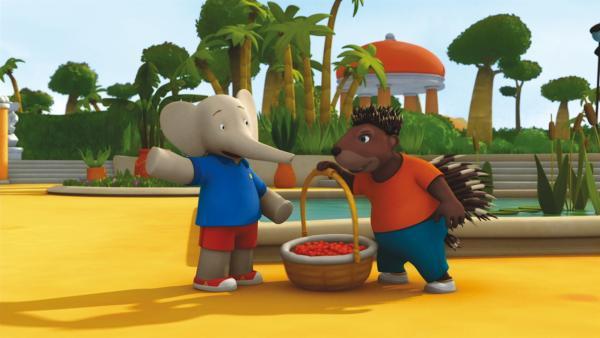 Badou und Munroe mit einem Korb voller Sonnenbeeren. | Rechte: KiKA/Nelvana Limited
