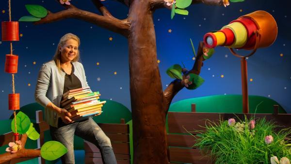 Singa erzählt von der Bibliothek. | Rechte: KiKA/Dorit Jackermeier