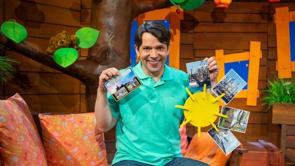 Juri bastelt eine Klammer-Sonne für seine Postkarten. | Rechte: KiKA/Dorit Jackermeier