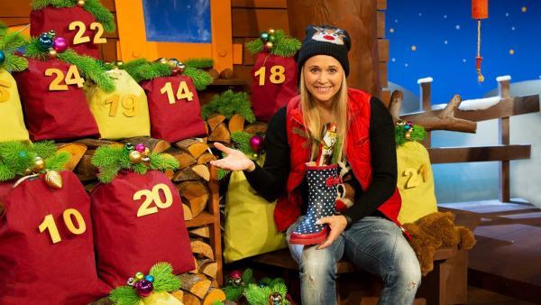 Singa erklärt den Unterschied zwischen Nikolaus und Weihnachtsmann. | Rechte: KiKA/Nadja Usbeck
