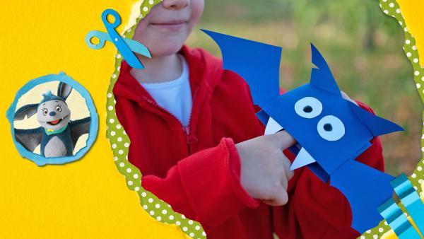 Falte das Papier und bastle eine Fledermaus-Handpuppe! | Rechte: KiKA