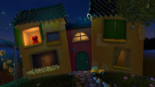 Elmo schaut bevor er ins Bett geht aus dem Gute-Nacht-Haus. | Rechte: KiKA