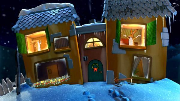 Kleiner brauner Hase und großer brauner Hase sagen Gute Nacht aus dem Gute-Nacht-Haus. | Rechte: KiKA
