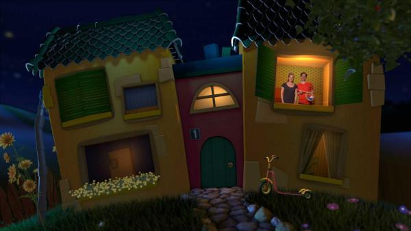 Singa und Juri stehen am Fenster im Gute-Nacht-Haus. Juri hat eine Mischpalette und einen Pinsel in der Hand.  | Rechte: KiKA