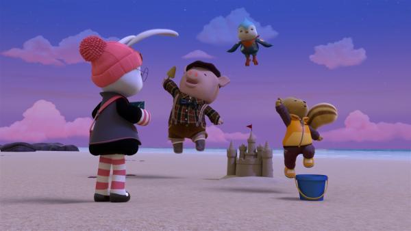 Rumy, Jay und Bean bauen eine Sandburg.   Rechte: BR/Enpop Co. Ltd.