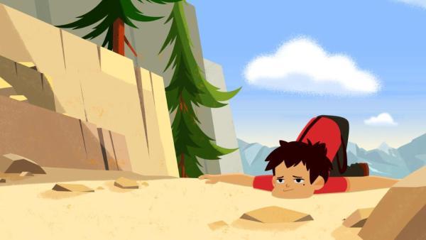 Sebastian liegt erschöpft auf dem Boden. Er ist auf einem Berg. | Rechte: © 2017 Gaumont Animation, PVP Animation III Inc.- All rights reserved
