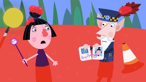Bei der Überprüfung des Zauberausweises von Nanny Plum stellt sich heraus, dass dieser abgelaufen und ungültig ist. | Rechte: ZDF/Astley Baker Davies Ltd/Rubber Duck Entertainment