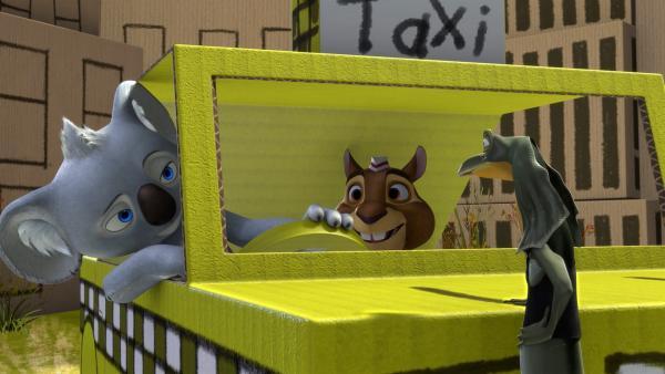 Blinky und Jacko holen New York nach Greenville und zeigen Eddie in ihrem selbstgebastelten Taxi die Sehenswürdigkeiten der Kartonmetropole. | Rechte: KiKA/Studio 100 Media / Flying Bark