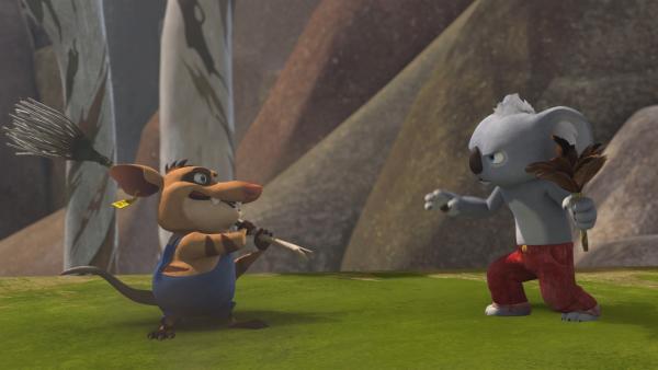 Blinky und Bandi wollen sich gegenseitig beweisen, wer besser mit Besen und Staubwedel umgehen kann.    Rechte: KiKA/Studio 100 Media / Flying Bark