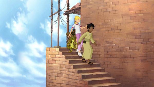 Cora, Habib und die Wonderers finden sich auf dem Dach eines gewaltigen Turmes wieder. Gerade wollen sie C.T. nach der Bibelgeschichte fragen, da entgleitet Cora die Schultasche. | Rechte: KiKA/Cross Media/Beta/Trickompany 2010