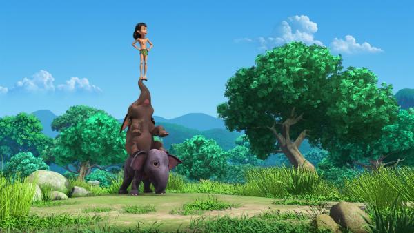 Die Elefantenkinder Appu und Hita sind ganz aufgeregt. Heute soll Elefantenbesuch kommen. Ob Mogli von da oben den Besuch schon sehen kann? | Rechte: ZDF/DQ Entertainment
