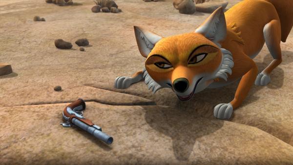 Tabaqui findet eine alte Pistole und hat eine Idee: Mit der Waffe will er die Tiere davon überzeugen, dass Menschen im Anmarsch sind. | Rechte: ZDF/DQ Entertainment