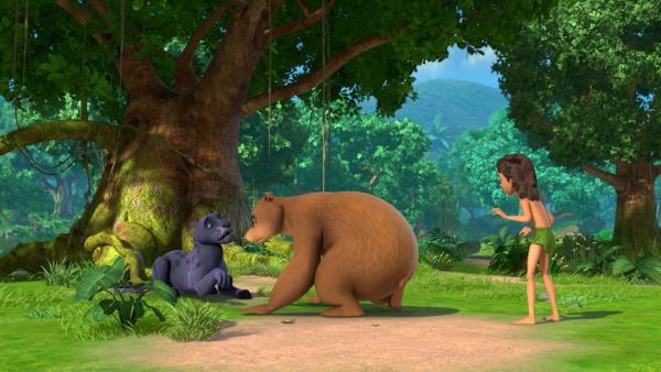 Balu untersucht Baghiras Pfote, denn der Panther hat sich einen giftigen Dorn eingetreten.   Rechte: ZDF/2009(c) DQ Entertainment