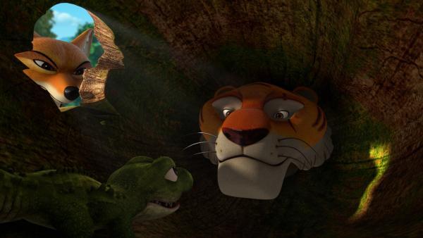 Das Krokodilkind muss aufpassen, denn Tabaqui und Shir Khan haben nichts Gutes im Sinn. Shir Khan gibt vor, das Regenbogen-Krokodil zu sein.   Rechte: ZDF/2009(c) DQ Entertainment