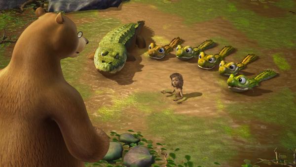 Jakala das Krokodil, bringt ihren fünf Söhnen bei, menschliche Beute zu jagen. Mogli (Mitte) soll ihr Festmahl werden.   Rechte: ZDF/DQ Entertainment