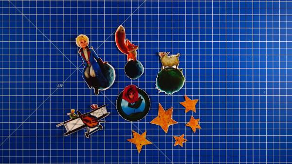 die fertig ausgeschnittenen Ojekte und Figuren für das Planeten-Mobile | Rechte: KiKA