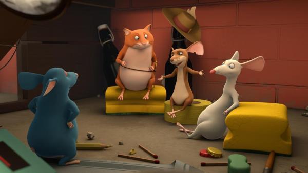 Die vier Muskeltiere sind in ihrem Unterschlupf, sitzen zusammen in einer Runde und besprechen etwas. | Rechte: 2021 Caligari Film