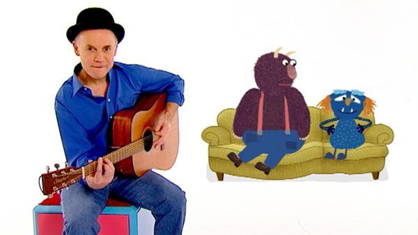Robert Metcalf singt gemeinsam mit zwei Monstern ein Lied über das Autofahren. | Rechte: WDR