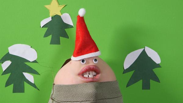 Ein weihnachtliches Kinngesicht singt ein Lied. | Rechte: KiKA