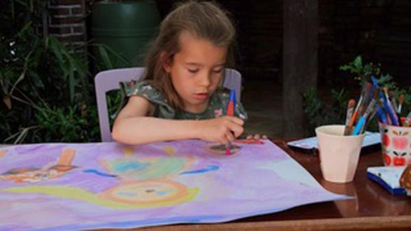 Loretta malt ein Bild. | Rechte: KiKA/Motion Works GmbH