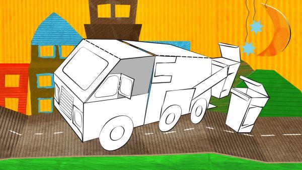 Das gebastelte Müllauto aus Papier von ENE MENE BU fährt durch eine Stadtlandschaft.   Rechte: KiKA
