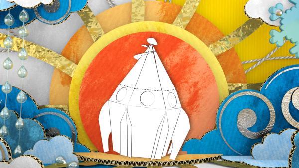 Das gebastelte Raumschiff aus Pappe von ENE MENE BU vor einer Sonne aus Papier.   Rechte: KiKA