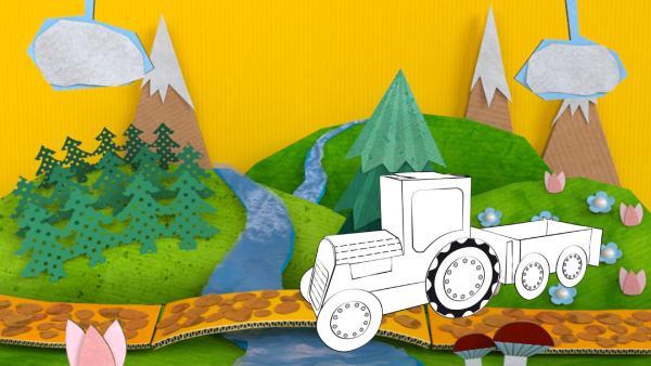Der gebastelte Traktor aus Papier von ENE MENE BU fährt über eine Brücke im Wald.   Rechte: KiKA