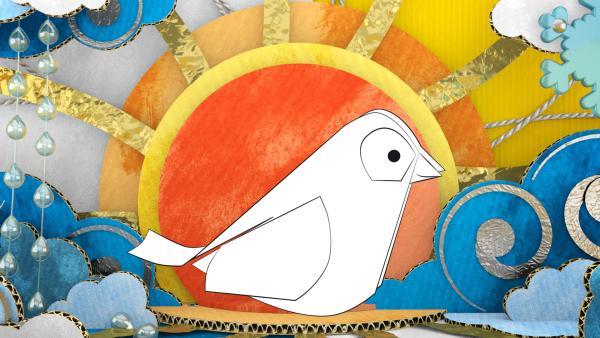 Der gebastelte Vogel aus Pappe von ENE MENE BU im Sonnenuntergang.   Rechte: KiKA