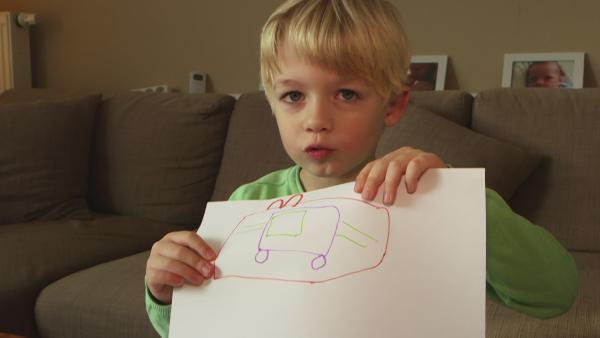 Tom malt ein Geschenk   Rechte: KiKA