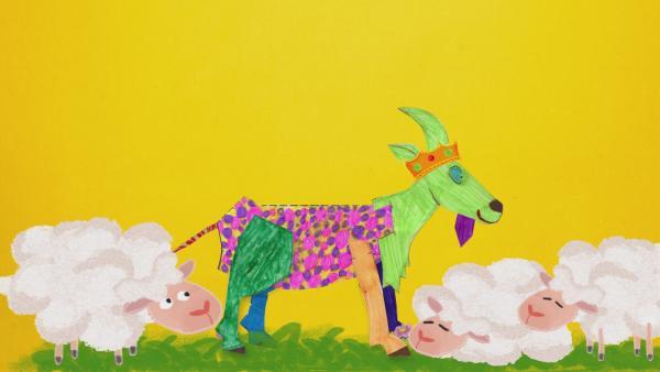 Eine grüne, lila gepunktete Steckziege steht in einer Schafherde. | Rechte: KiKA