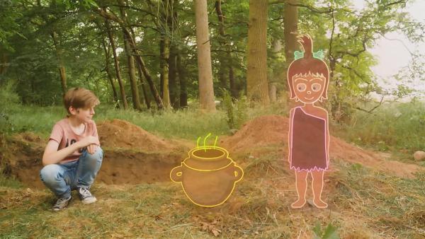 Zukunftsmacher Julius gräbt nach alten Keramikscheiben aus der Bronzezeit. | Rechte: KiKA