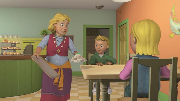 Gwendolyn reicht Sarah und James Sandwiches. | Rechte: KiKA/2011 Prism Art & Design Limited