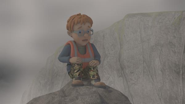 Norman hat große Angst, allein auf dem Felsen.   Rechte: KiKA/2014 Prism Art & Design Limited