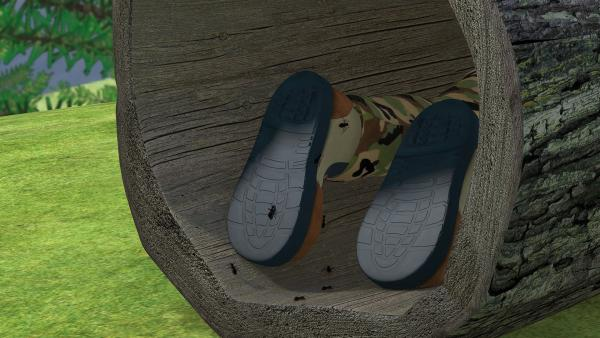 In Normans Versteck gibt es Ameisen, die an seinem Bein hochkrabbeln. | Rechte: KiKA/2014 Prism Art & Design Limited