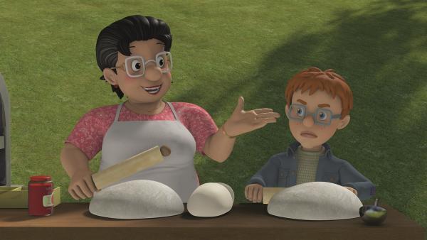 Norman muss Bella an ihrem Pizzastand helfen.   Rechte: KiKA/Prism Art & Design Limited