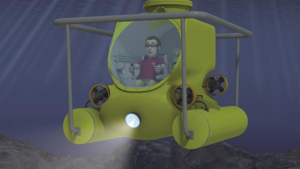 Joe Sparkes hat sich selbst ein U-Boot gebaut und geht damit auf Entdeckungstour.   Rechte: KiKA/Prism Art & Design Limited