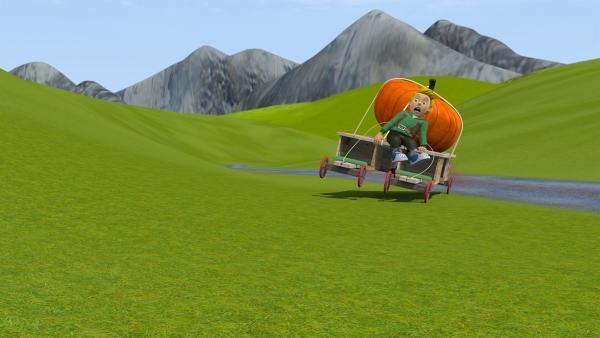 James will den Kürbis mit einem Rollwagen zum Wettbewerb bringen. Doch er kann das Gefährt nicht steuern. Unkontrolliert rast er durch die Gegend. | Rechte: KiKA/Prism Art & Design Limited
