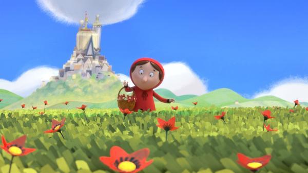 Rotkäppchen sammelt Blumen, um sie in der Stadt zu verkaufen. | Rechte: ZDF/Magic Light Pictures Ltd.