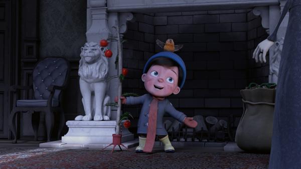 Henry hat es geschafft: Wie der Weihnachtsmann kommt er durch Frau Beeses Kamin und bringt Weihnachtsschmuck mit. | Rechte: KiKA/Dream Logic & Lupusfilm/Trickshot Films