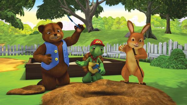 Franklin, Bär und Kaninchen spielen Archäologen und graben im Garten nach Überresten von Dinosauriern. | Rechte: KiKA/Nelvana Limited/Infinite Frameworks  Pte Ltd.
