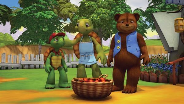Franklin und Bär sollen mit Vater Schildkröte auf Herrn Murmeltiers Garten aufpassen. | Rechte: KiKA/Nelvana Limited/Infinite Frameworks Pte Ltd.
