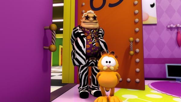 Garfield unterbricht den Dreh an dieser Episode und läuft schnurstracks in das Büro seines Produzenten, da er mit den eingespielten Lachern nicht einverstanden ist. | Rechte: HR/DARGAUD MEDIA