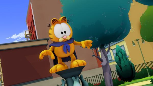 """Garfield genießt seinen Ruhm als Superheld. Mittlerweile gibt es sogar schon Actionfiguren vom """"Rächer mit dem Umhang"""".   Rechte: HR/DARGAUD MEDIA"""